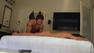Massuer is stimulating honey's cunt with vibrator after massage